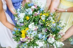 Image by Laura De-Bourde Photography - DIY Wedding In London With Bride In Justin Alexander And Bridesmaids In Mismatched Pastel Gowns With Wild Flower Bouquets And Fun Vinyl Record Guest Book