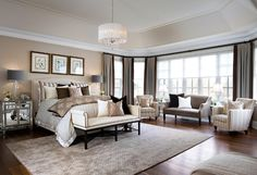 """A vaulted tray ceiling defines the parameters of the space in this elegant bedroom, giving it a distinct, unique feel. Chairs are the """"Suzanna chairs"""" and settee is the """"Stanwyck"""", both Jane by """"Jane Lockhart Designs"""". The drapery fabrics are by Robert Allen, the blinds are by Allure Window Decor. Bedroom Ideas. Tailored Bedroom Design with elegant furniture and decor. #Bedroom #TailoredBedroom #TailoredDesign #BedroomIdeas #BedroomFurniture #BedroomColorPalette Designed by Jane Lockhart."""