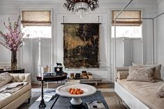 Darryl Carter, the Washington-based designer, flipped over the Aubusson rug in his cool-gray-and-white room to expose the weave. He ripped a 19th-century landscape from its frame to make the piece at center.