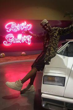 Kid Cudi wearing  Bape Camo Onepiece Shirt, Jordan Don C Beach 2 Sneakers, Bape Limited Kid Cudi T-Shirt, Ray-Ban Clubmaster Tortoise 49mm Sunglasses