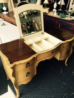 Beautiful French Provincial vanity with a re-finished top but original paint on the bottom! Sometimes less is more!