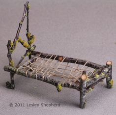 Woven mattress support in a miniature bed made from twigs - Photo © 2011 Lesley Shepherd