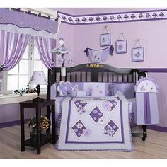 Dress up and decorate your baby's room with this beautiful 13-piece lavender butterfly crib bedding set. This set includes a crib quilt, two valances, skirt, sheets, bumpers, diaper stacker, toy bag, two throw pillows and three wall hangings.