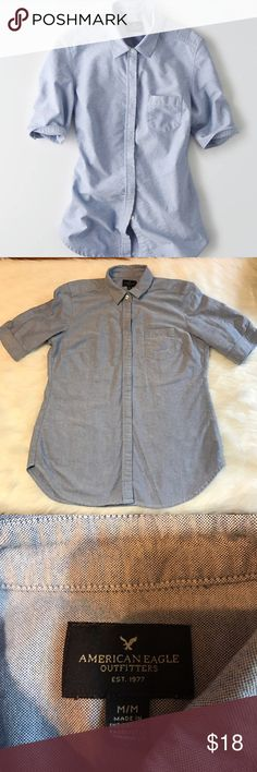 AEO women's short sleeve oxford Women's American Eagle Outfitters short sleeve oxford button down shirt in excellent used condition. Size medium. Includes two replacement buttons still attached to inner side of shirt. 100% cotton. Buttons are covered by extra flap of fabric American Eagle Outfitters Tops Button Down Shirts