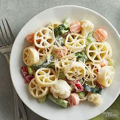 Easy Pasta Primavera The shape of the wagon wheel pasta is perfect for capturing…
