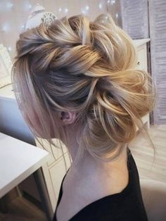 Beautiful braided messy bun boho bridal hairstyle