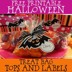 Free printable Halloween treat bags -- tops and labels  (there also garland and other freebies for this party)