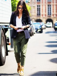 A white v-neck is paired with green cargo pants, a navy blue blazer and brown heeled sandals.