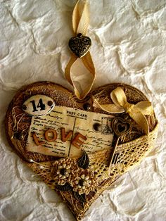 lovely vintage heart - I'm thinking this could be done with sandwiched cardboard hearts....