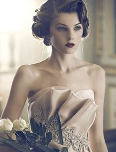 Vintage hair:  I could so see Gia in her face!  Gorgeous look:  dress, hair, makeup, flowers..........