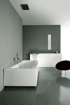 square white shapes and round black chair details #bathroom