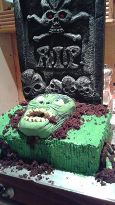 Zombie cake I made for my son's 9th Birthday.   The headstone is not edible.