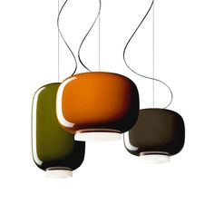 The Chouchin family (2011) from Foscarini is a collection of three suspension lights made of blown glass of various shapes, sizes and colors. Comes in three shapes, each with it's own color: orange in large, gray in small and green in the elongated version.