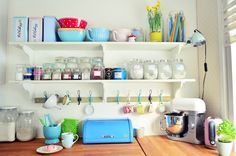 Lovely colors throughout her home and these open shelves are so tempting right now!