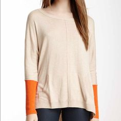 "Vertical Designs Hi Lo Colorblock Sweater size M Vertical Designs Hi Lo Colorblock Sweater size M in Dune Heather/ Orange Spice retail $108 EUC Details: - Scoop neck  - Long sleeves  - Colorblock design  - Hi-lo hem - Approx. 25"" shortest length, 30"" longest length  - Imported  Fiber Content: 75% rayon, 25% nylon Care: Machine wash cold with like colors Additional Info: Fit: this style fits true to size.  Model's stats for sizing: - Height: 5'8.5"" - Bust: 32"" - Waist: 24"" - Hips: 34"" Model…"
