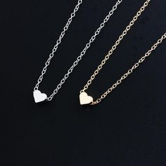 """This gorgeous necklace is proof that beautiful things come in small packages. Customers will enjoy a durable zinc alloy material, adjustable link chain, and gold or silver plated designs when they choose our tiny heart pendant necklace. It is the gift that says, """"I Love you,"""" to all of your friends and family. Whether you're looking for Christmas, Valentine's Day, Birthdays, or for yourself, you simply can't go wrong!"""