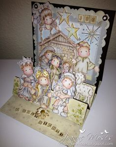 A step-easel card using 14 of the 26 stamped images from Magnolia's Nativity Collection 2012