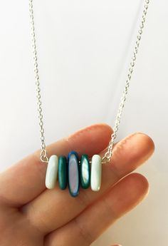 Polished Shell Beaded Pendant Necklace, Beach Necklace. Check it out in my shop! https://www.etsy.com/listing/482027640/beach-necklace-handmade-necklace #shellnecklace #poishedshells #handmadenecklace #handmadejewelry #nauticaljewelry #pendantnecklace #blueshell #tealshell #tealpendant #shellbeads