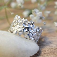 Filed of clover sterling silver ring - $135 / A mosaic of three leaf clovers of various shapes and sizes encircle one slightly larger four leaf clover on this wide band lacy ring.