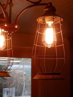 Repurposed a Reclaimed Light Fixture and Turned it Into This using 3 lantern cages.