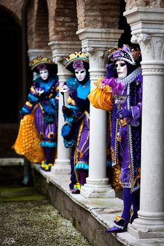 The Venice Carnival...brightly costumed revelers among the ancient columns!