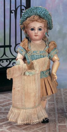 """French Bisque Bebe Jumeau  15"""" (38 cm.) Bisque socket head,blue glass paperweight inset eyes, pierced ears,blonde mohair wig over cork pate,French composition and wooden eight-loose- ball jointed body with straight wrists. Marks: Depose 6 (incised,and artist checkmarks on head) Jumeau Medaille d'Or Paris (body). Comments: Emile Jumeau,circa 1885,"""