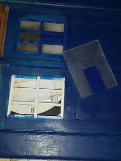 mounting the perspex windows. sadly I was requested to make the frames blue rather than the original white.