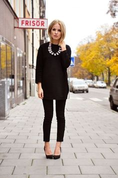 Love the black look and skinny pants--dress up or down with necklace or scarf