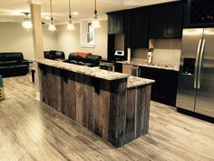A customer in Roswell used our reclaimed barn wood planks wrapping a kitchen island.