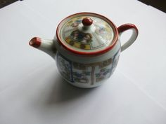 ORIENTAL CHILDS TEASET TEAPOT OR ORNAMENT CERAMIC VINTAGE