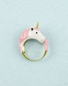 Pink Unicorn Ring by Modernaked on Etsy. I apparently just really want a unicorn ring.