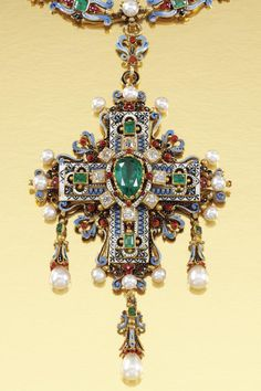 A RENAISSANCE REVIVAL, GOLD AND GEM-SET NECKLACE, ERNESTO RINZI, 1870. Designed as a series of polychrome enamel scrolls embellished with step-cut emeralds, interspersed with pearls and circular-cut diamonds, suspending a Latin cross of matching design centring on a pear-shaped emerald and terminating on three pearl drops, length approximately 360mm, cross detachable, with maker's mark ER for Ernesto Rinzi. #Rinzi #RenaissanceRevival #necklace
