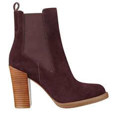 Double gore details create a sleek fit on these round toe casual luxe chelsea booties with raw stacked heel.
