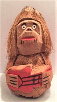 Carved coconut monkey playing a guitar by HoardersHideaway on Etsy