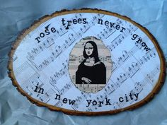 Mod podged sheet music scrapbook paper to wooden plaque bought at Michael's, added middle picture with burnt edges, stamped on some lyrics and topped off with a few more layers of mod podge! Cutesies!