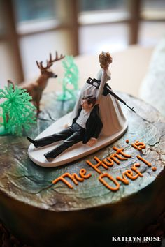 "Bahaha, every time me and mom see this one at Walmart, we say this is the one I'll use. ""The Hunt Is Over"" country wedding cake topper"