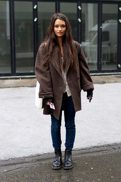 London Street Style  with oversized dark brown coat, cream button up blouse, blue skinny jeans, oversize tote and black lace up boots. #streetstyle
