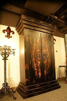 Beautiful Old World, Gothic Architecture style Armoire/cabinet. With Burnished Angel Wings