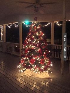 Nice - A Christmas Tree on the porch..oh heck yes!   CHECK OUT MORE PORCH AND SCREEN DOOR IDEAS AT DECOPINS.COM   #porch #porches #screendoor #screendoors #outside #exterior #homedecor #porching