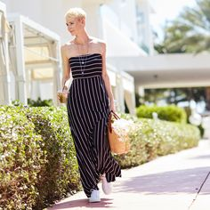 Sophisticated stripes are perfectly placedon this maxi dress that comes with detachable straps.