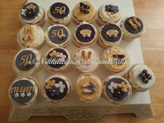 purple / gold / white tiny shoe cupcakes