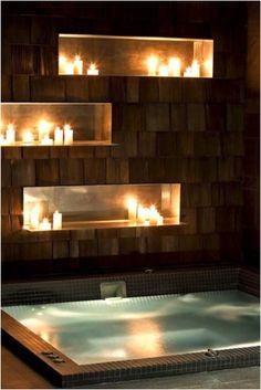 baño con tina y repisas en pared