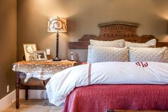 @Ballard Designs headboard, axis throw, monogrammed comforter.  1080 Drake Street, Montara, CA 94037 - PlanOmatic.com