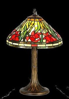 GF12054 This is a beautiful stained glass lamp made with individual hand-cut pieces of glass soldered together to make this gorgeous lamp. It is hand crafted using the same rich techniques and designs