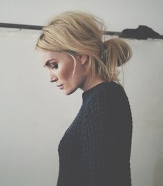 messy bun + cable knit sweater.