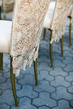 Gorgeous chair slips: http://www.stylemepretty.com/texas-weddings/san-antonio/2015/02/27/whimsical-zoo-styled-shoot-at-san-antonio-zoo/ | Photography: Diaz & Diaz - http://www.diazanddiaz.com/