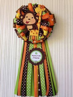 This cute handmade Baby Shower (Mommy) corsage, monkey and Giraffe is made with stock card paper. Diameter of bow approx. 7 1/2 Total length of