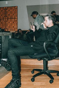 G-Eazy wearing  Saint Laurent Mid Jeans, Supreme x Nike Air More Uptempo