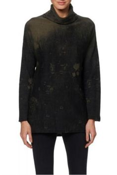 This edgy yet chic turtleneck tunic is crafted in soft cotton and features a skull design on back with an allover acid wash effect. Dropped shoulders. Deep side vents. Turtleneck Tunic by Skull Cashmere. Clothing - Sweaters - Turtleneck Las Vegas