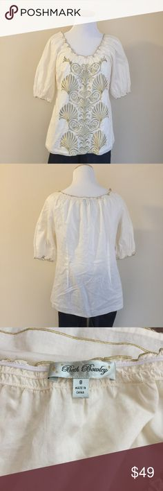 "Anthropologie Beth Bowley embroidered boho top sz8 Anthropologie Beth Bowley embroidered boho peasant top, size 8.  Cream color with gold embroidery embellishment and trim, elastic neckline and sleeve openings, front is fully lined, sleeves/back are unlined.  Condition:  excellent pre-loved.  Flaw:  very small 1/8"" faint mark on right rear shoulder, see photo 4.  Material:  shell and lining 100% cotton.  Measurements (approximate, taken laying flat): length 24"", pit-to-pit 19"", flat hem 20""…"